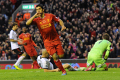 Suarez fires at the Kop